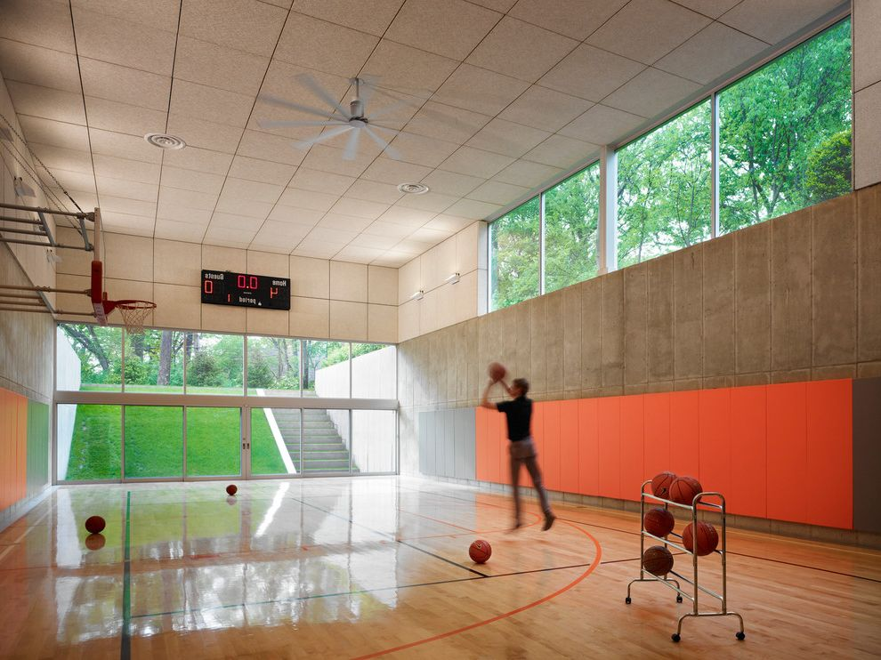 How Much Does a Basketball Court Cost with Contemporary Home Gym  and Basketball Basketball Court Ceiling Fan Ceiling Fans Concrete Wall Custom Courts Home Gym Large Windows Recessed Lighting Sliding Doors Tall Ceilings