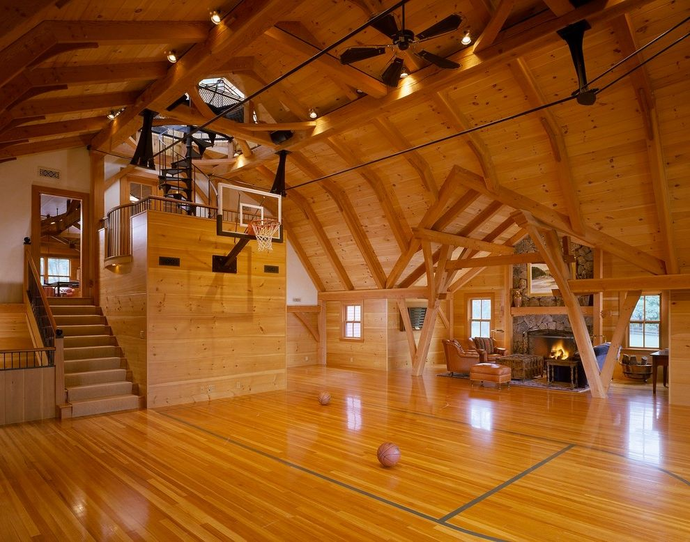 How Much Does a Basketball Court Cost with Farmhouse Home Gym  and Basketball Barn Bensonwood Country Home Dewing Schmid Kearns Architects Indoor Basketball Court Modern Farmhouse Rustic Wood Timber Frame Wood Beams