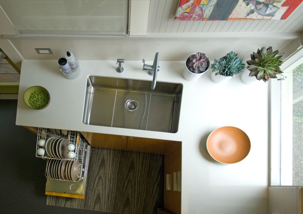 How Much Water Does a Dishwasher Use   Contemporary Kitchen  and Beadboard Wall Caesarstone Countertop Faucet Orange Cabinets Sink Small Dishwasher Small Kitchen Small Space Stainless Steel Sink White Countertop Wood Cabinet Wood Floor