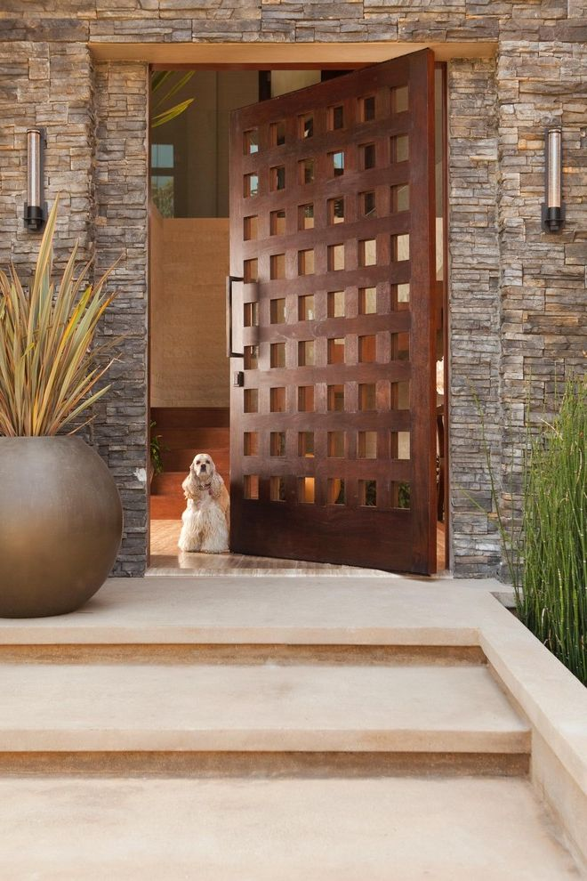 How to Fix a Hole in a Door   Rustic Entry Also Container Plants Dog Entrance Entry Frank Loyd Wright Front Door Horsetail House Numbers Mid Century Modern Neutral Colors Outdoor Lighting Planters Potted Plants Ramon Ebove Rustic Stairs Steps Stone Wall