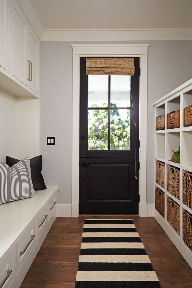 How to Fix a Hole in a Door   Transitional Entry Also Black Exterior Door Built in Bench Crown Molding Cubby Holes Drawers Under Bench Entry Storage Ideas Light Gray Wall Wicker Baskets Wicker Window Treatment Wide Plank Floor