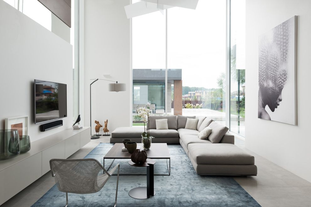 Jerome's Couches   Contemporary Living Room  and Blue Area Rug Cement Floor Clerestory Windows Curtain Wall Gray Sectional Large Artwork Large Window Minotti Modulnova Poliform Porada Wall Mounted Tv