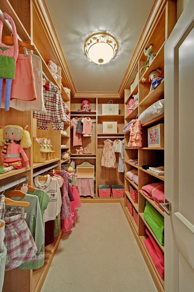 Kids Closet Connection with Traditional Closet  and Built Ins Carpeting Ceiling Light Dressing Room Entry Girls Room Hanging Rods Toy Storage Wood Shelves