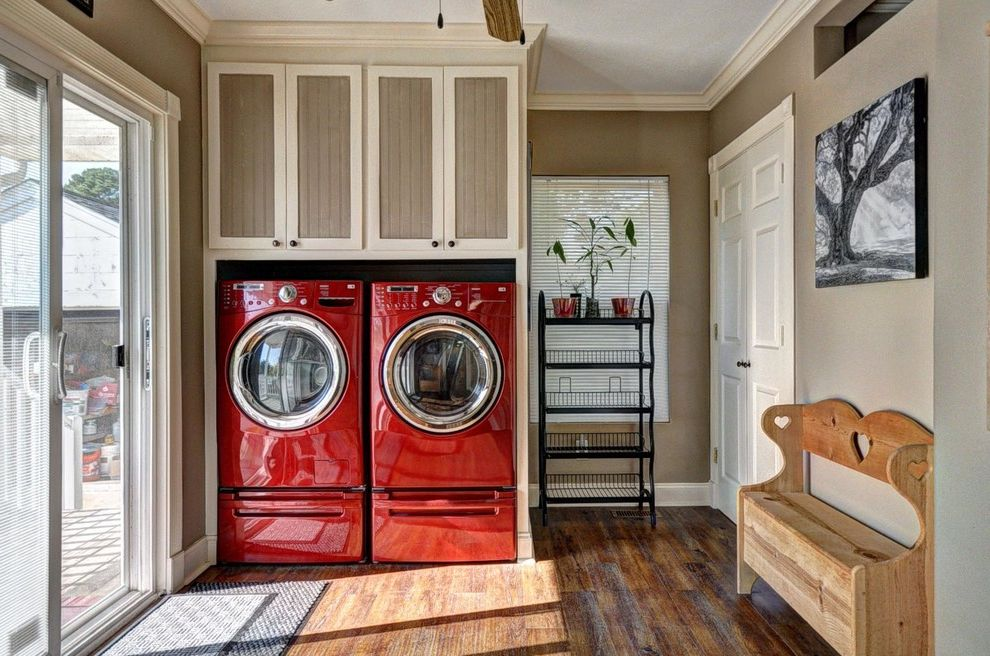 Lg Washer Dryer Pedestal with Traditional Laundry Room Also Beautiful Laundry Room Beige Walls Dark Hardwood Floors Mixed Color Cabinets Natural Lighting Red Washer and Dryer Ribbon Window Sliding Glass Doors