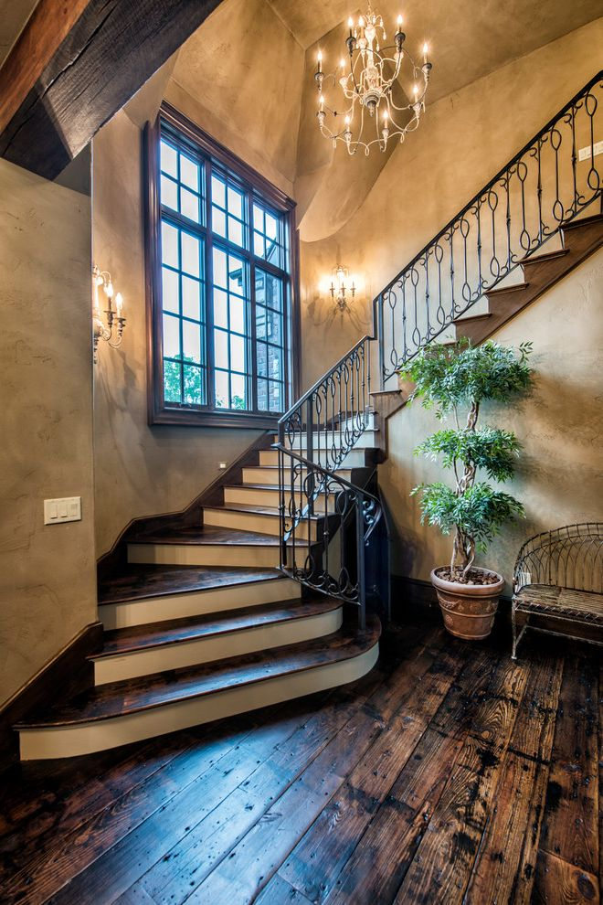 Locksmith Springfield Mo   Traditional Staircase  and Chandelier French Country Metal Railing Old World Rustic Wood Stones Wood Beams