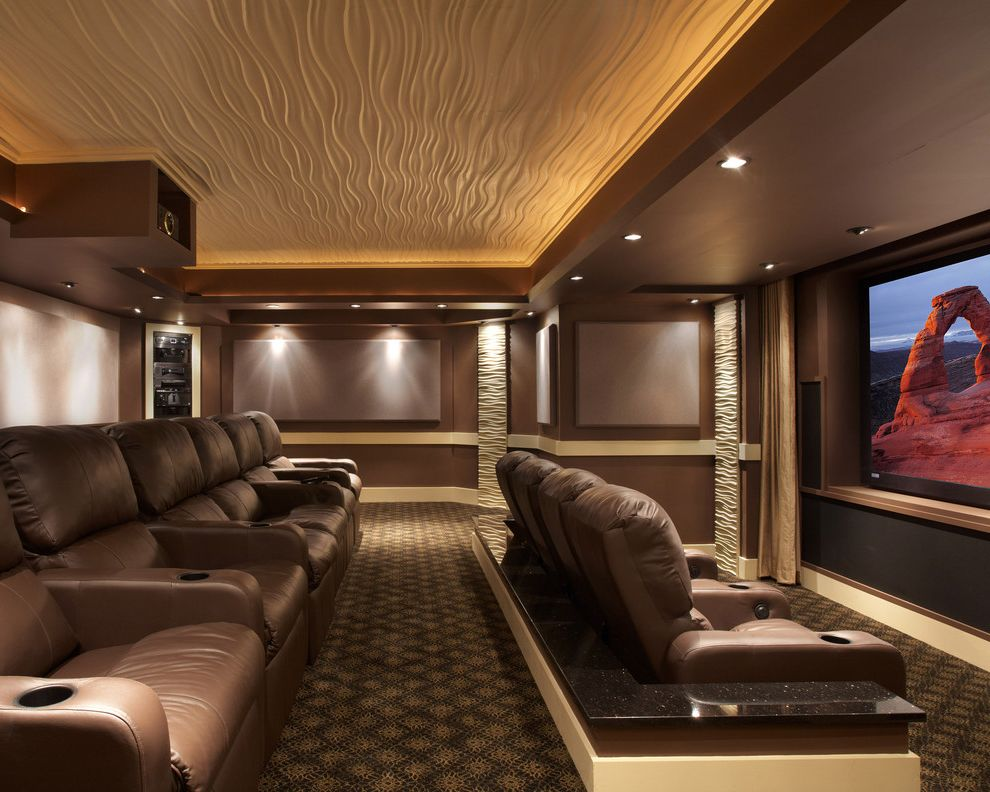 Los Banos Theater   Contemporary Home Theater Also Accent Lighting Brown Walls Home Theater Leather Lounge Chairs Media Room Movie Room Patterned Carpet Projector Projector Screen Stadium Seating Textured Ceiling Textured Pillars