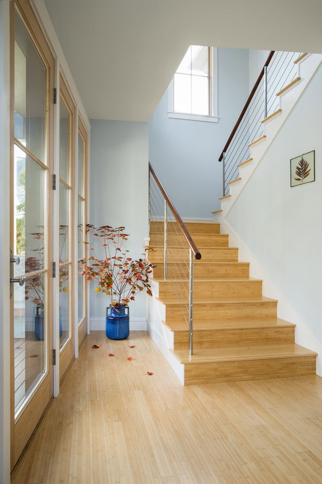 Lowes Bamboo Flooring with Transitional Staircase Also Autumn Leaves Bamboo Floors Cable Rail Cable Railing Custom Home Entry Hall Light Blue Walls Light Wood Floor Light Wood Risers Light Wood Tread Maine Ocean View Seasonal Decor Vacation Home