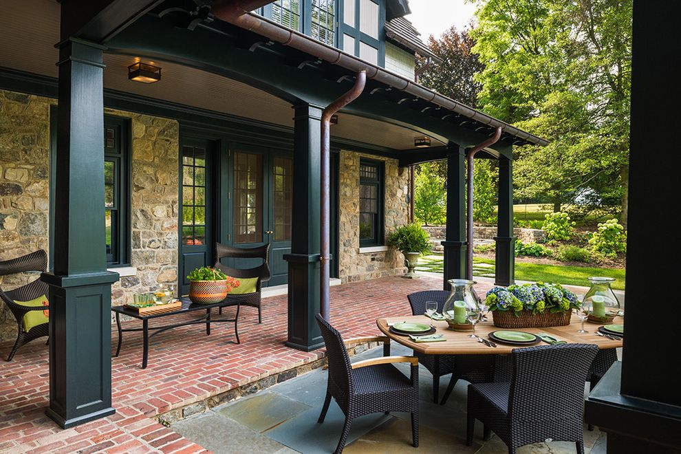 Lowes Bloomington in   Traditional Porch  and Black Column Black Pillar Black Trim Brick Patio Copper Pipes Dark Brown Outdoor Chair Dark Outdoor Dining Chair Outdoor Dining Outdoor Wood Table Stone Exterior Stone Patio Stone Siding Stone Wall