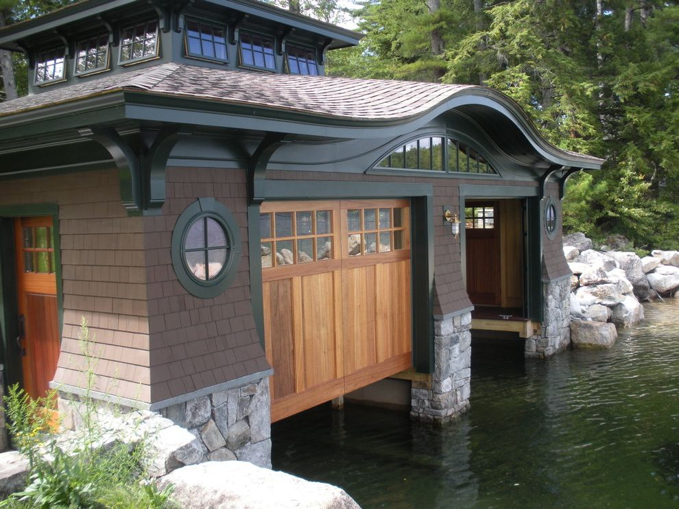 Lowes Essex Vt with Rustic Garage Also Aquatic Arch Window Awning Windows Boat House Boulders Brackets Curved Roof Flagstone Green Muntins Outdoor Sconce Porthole Window Shingles Stacked Stone Stones Water