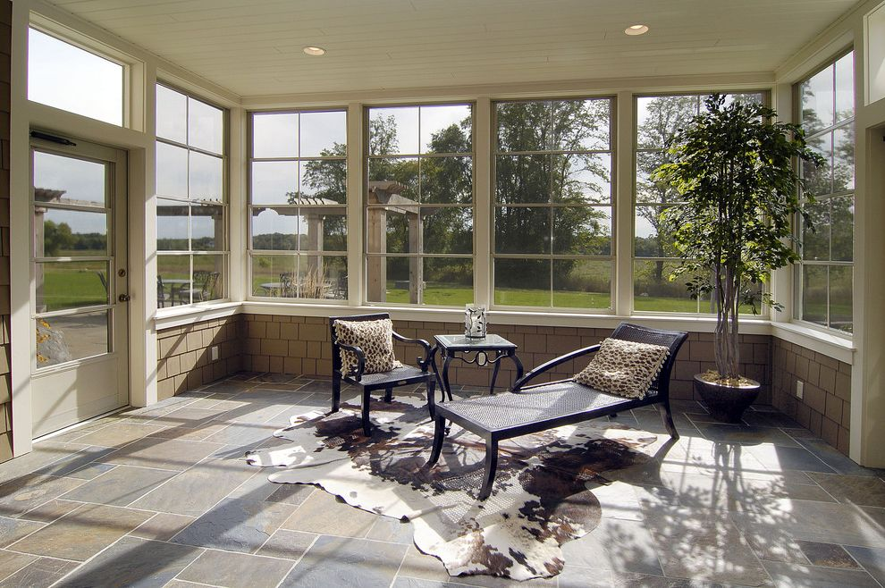 Lowes Hibbing Mn with Traditional Sunroom Also Chaise Longue Chaise Lounge Cowhide Rug Double Hung Windows Potted Plants Screen Door Shingle Siding Slate Floor Sunroom