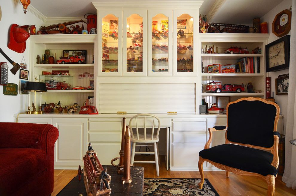 Lowes Paso Robles   Farmhouse Family Room Also Arm Chair Black Built in Bookshelves Built Ins Cabinets Department Fire Fire House Fireman Glass Front Cabinets Queen Anne Raised Panel Cabinets Red Red Velour Sliding Doors Sofa Tambour Toys Vintage