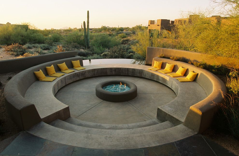 Lowes Scottsdale   Mediterranean Patio  and Cactus Circular Fire Pit Concrete Patio Contemporary Desert Landscape Large Fire Pit Round Firepit Yellow Pillows