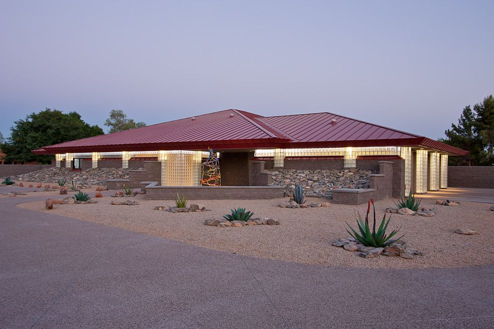 Lowes Scottsdale with Contemporary Exterior  and Boulders Desert Landscape Garden Sculpture Glass Blocks Gravel Landscape Low Pitch Roof Low Slope Roof Metal Roof Pavers Plants Red Roof Rocks Standing Seam Roof Stones