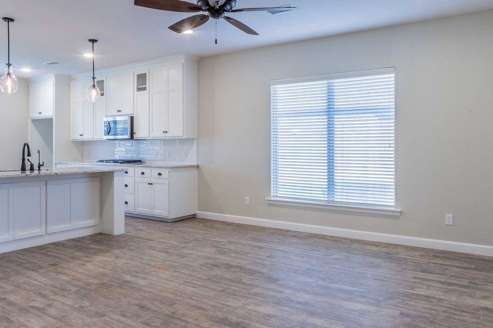 Mark Payne Homes with Contemporary Living Room  and Open Kitchen Townhome Wood Tile