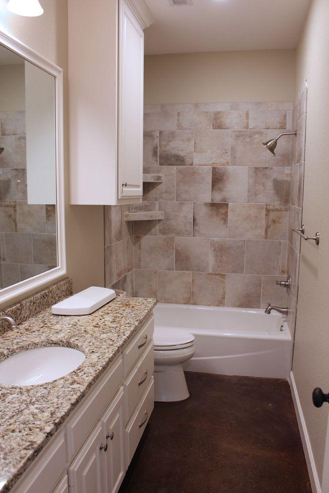 Mark Payne Homes with Transitional Bathroom Also Bathroom Lighting Beige Walls Brushed Nickel Hardware Concrete Flooring Downlights Wall Mounted Cabinet White Trim White Trim Mirror White Vanity Wood Vanity