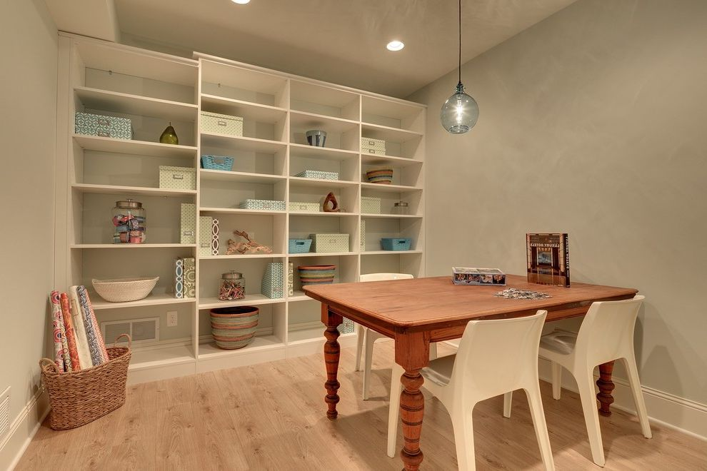 Mattamy Homes Mn   Traditional Basement Also Baseboard Basket Built in Shelves Craft Room Craft Storage Hobby Room Home Office Light Blue Painted Wall Light Wood Floor Neutral Colors Pendant Recessed Light White Chairs Wood Table