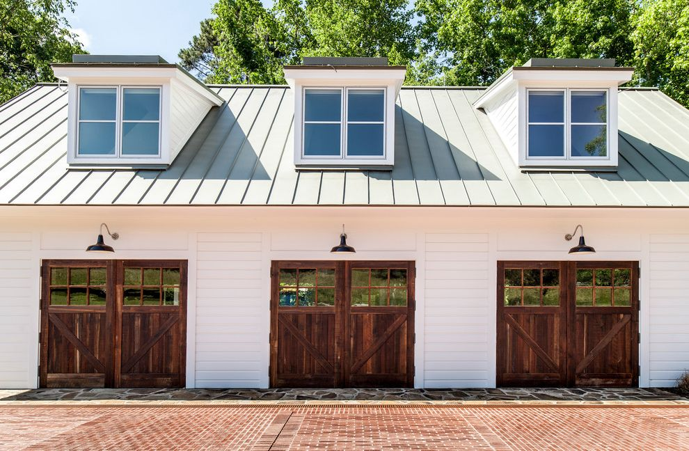 Metal Garage with Apartment   Farmhouse Garage Also Automatic Barn Board Brick Pavers Bronze Dormer Windows Farm Garage Glass Garage Door Reclaimed Repurposed Rustic Standing Seam Metal Roof Wood Wood Garage Doors