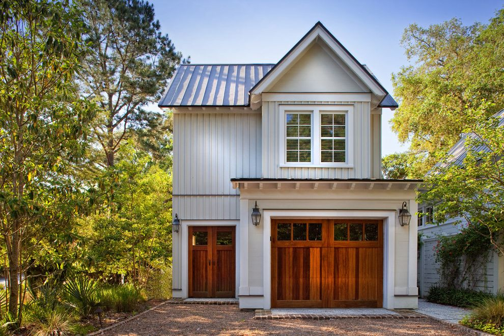 Metal Garage with Apartment with Traditional Garage Also Board and Coach Lights Coastal Living Cottage Cross Gabled Roof Palmetto Bluff White Framed Windows Wood Siding Wooden Doors Wooden Garage Door