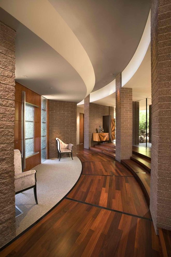 Moving Picture App   Contemporary Entry Also Brick Walls Columns Curved Walls Dark Floor Foyer Front Door Minimal Stairs Steps Wood and Tile Floor Wood Flooring