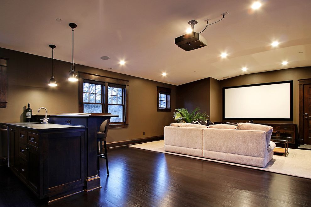 Oro Valley Theater with Contemporary Basement  and Area Rug Brown Counter Stools Home Bar Island Pendant Lights Projection Screen Recessed Lights Sofa Wood Floor