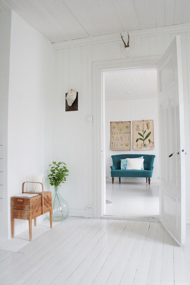 Really Cheap Floors with Scandinavian Living Room  and Botanical Prints Demijohn Love Seat Painted Floorboards Painted Wood Turquoise Wall Art Wall Decor White Floor Wood Ceiling Wood Flooring Wood Paneling