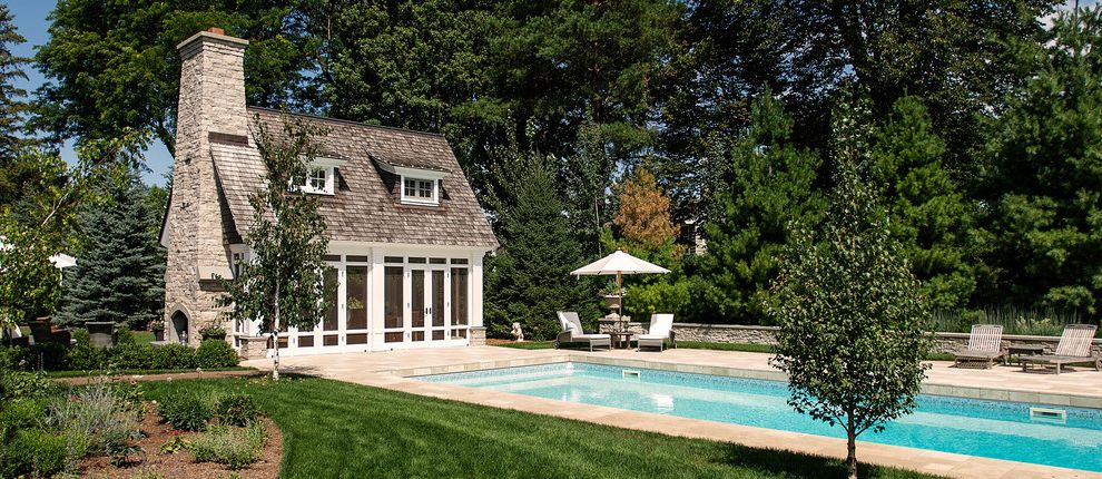 Remodelers Mart with Traditional Pool Also Cedar Cedar Roof Chimney Cottage Dormer Dormers Fireplace Grass Guest House Lawn Pool Pool House Poolside Planting Roof Shake Roof Stone Turf