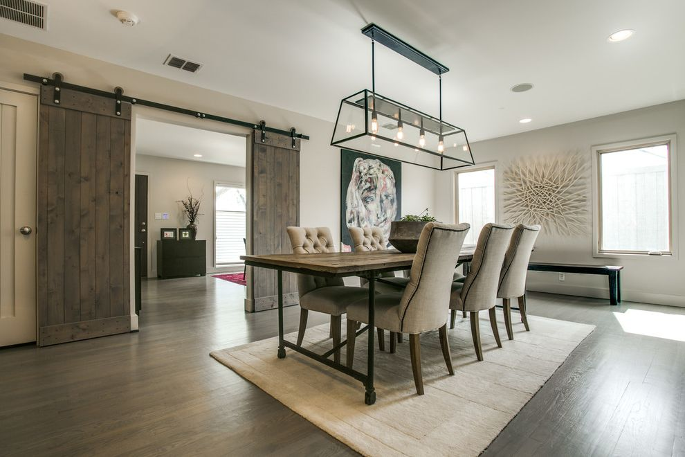 Restoration Hardware Dallas   Farmhouse Dining Room  and Area Rug Chandelier Dining Chairs Dining Table Grey Wood Floors Sliding Barn Doors