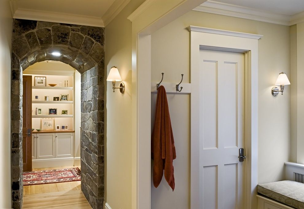 Restore Newington Nh   Traditional Hall  and Arched Doorway Built in Shelves Crown Molding Sconce Stone Wall Towel Racks Wall Lighting White Wood Wood Flooring Wood Panel Door Wood Trim