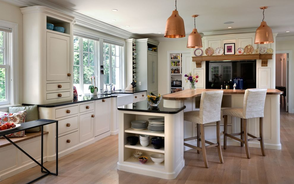 Restore Newington Nh with Farmhouse Kitchen  and Beige Bar Stools Black Countertop Copper Pendant Lights Curved Island Open Shelves Wine Rack Wood Bar Countert