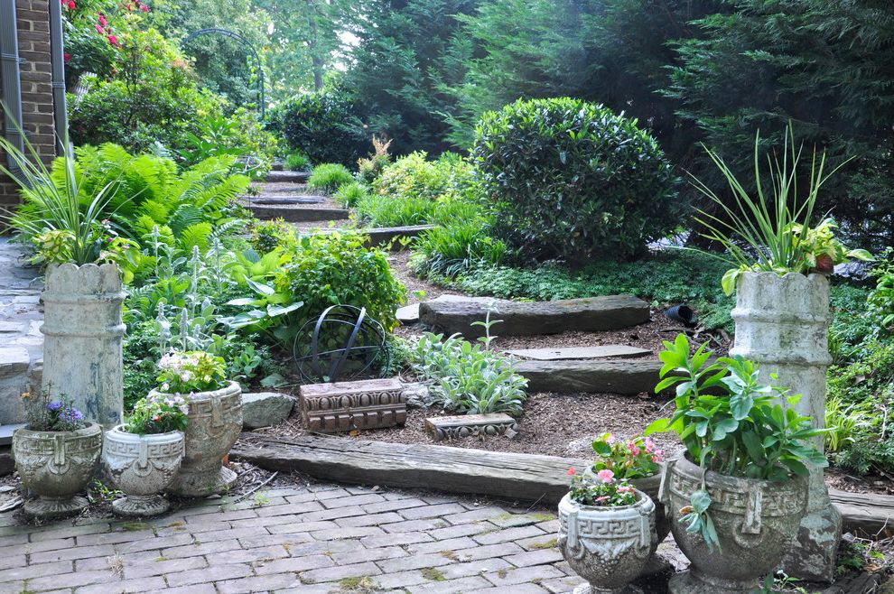 R&r Tires with Traditional Landscape  and Brick Patio Flowers Garden Path Garden Steps Gravel Path Grecian Urns Lush Potted Plants Rustic Wood Steps Shrubs Side Yard Tall Planters