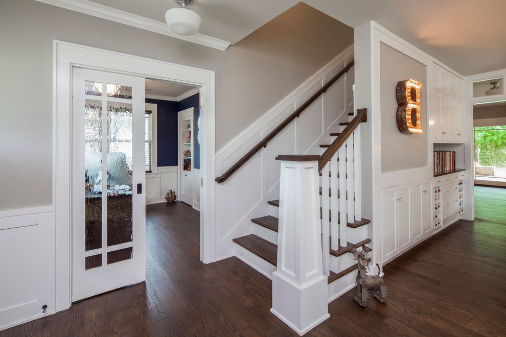 Sherwin Williams Flooring with Traditional Staircase  and Addition Austin Craftsman Dark Wood Stair Treads Gray Walls Pocket Doors Renovation Second Story Addition White Railing White Trim