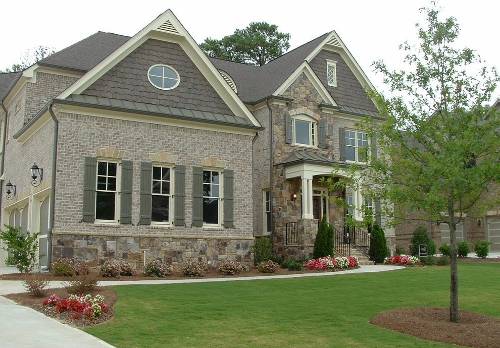 Sherwin Williams Nashville Tn with Traditional Exterior  and Brick French Influence French Stye Garage Carriage Doors Natural Cedar Shakes Stone Stone Column Base Stone Watertable Suburban Home