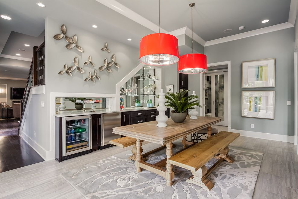 Sherwin Williams Nashville Tn with Transitional Basement  and Basement Basement Bar Bench Seating Buildout Dining Table and Bench Farm Table Gray Rug Mirrored Wall Pendant Chandelier Stairs Tile Pattern Tiled Floors Wine Cooler