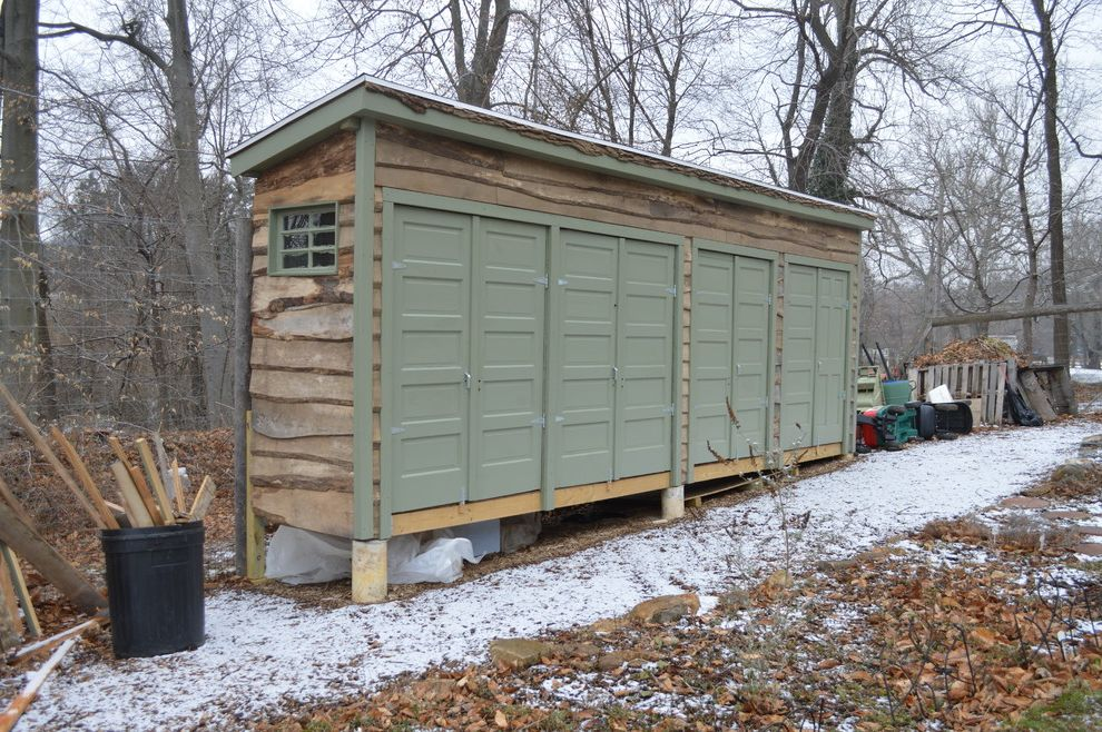 Shipping Container Storage Shed with Eclectic Shed Also Fallen Logs Gardening Shed Green Trim Live Edge Log Shed Outdoor Storage Repurposed Shed Snow Storage Shed