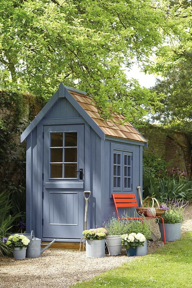 Shipping Container Storage Shed with Traditional Shed Also Bespoke Sheds Blue Shed Climbing Plants Garden Building Garden Shed Garden Sheds Garden Storage Gray Shed Pop of Color Potted Plants Red Bench Watering Can