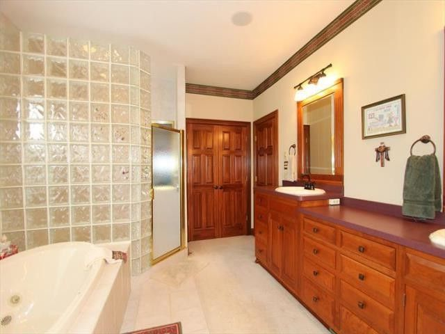 Sibcy Cline Cincinnati Ohio   Traditional Bathroom  and Ceramic Flooring Master Bathroom Owners Suite Private Retreat Seperate Shower Enclosed Soaker Whirlpool Tub Sound System Throughout