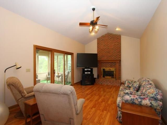 Sibcy Cline Cincinnati Ohio   Transitional Family Room Also Brick Gas Fireplace Ceiling Fan with Light Family Room with Hardwood Flooring Recessed Lighting Vaulted Ceiling Walkout to Sunroom