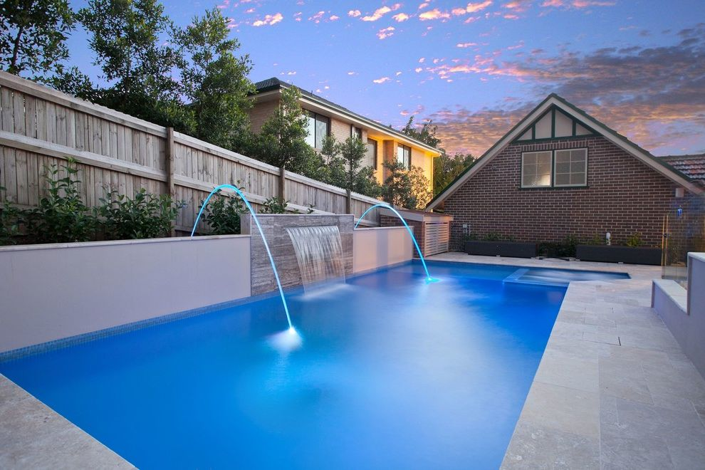 Spa at Falling Waters with Contemporary Pool  and Brick Exterior Brick Siding Hot Tub Integrated Hot Tub Pool Pool Water Feature Pool Water Fountain Pool Waterfall Stone Patio Stucco Wall Wood Fence