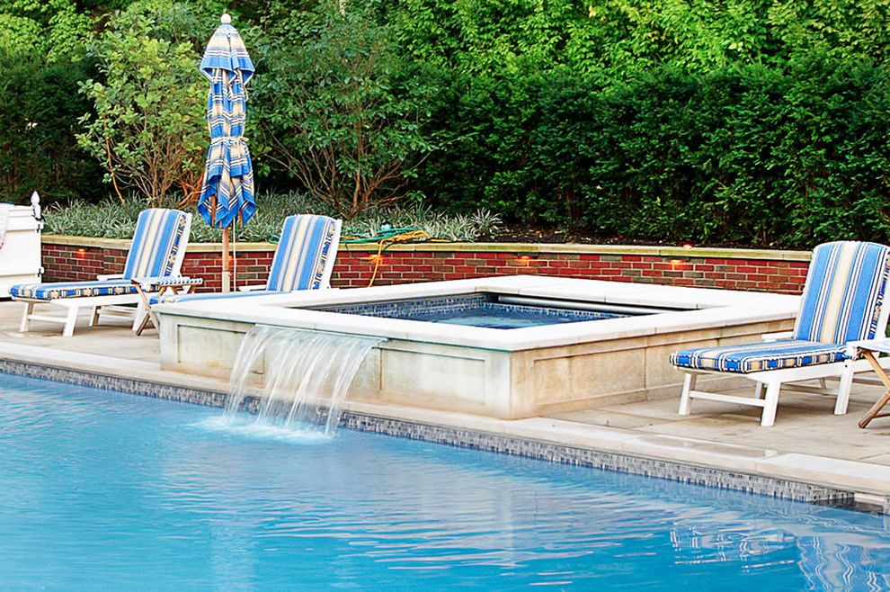 Spa at Falling Waters with Traditional Pool Also Brick Retaining Wall Landscape Outdoor Chaise Lounges Patio Patio Furniture Patio Umbrella Planting Pool and Spa Spas Swimming Pools