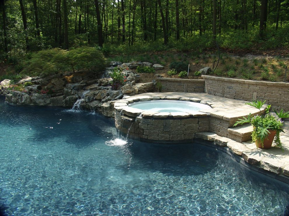 Spa at Falling Waters with Traditional Pool  and Aquatic Boulders Curved Hardscape Design Pavers Potted Plant Retaining Wall Rocks Spa Stacked Stone Steps Trees Water Fall Water Feature