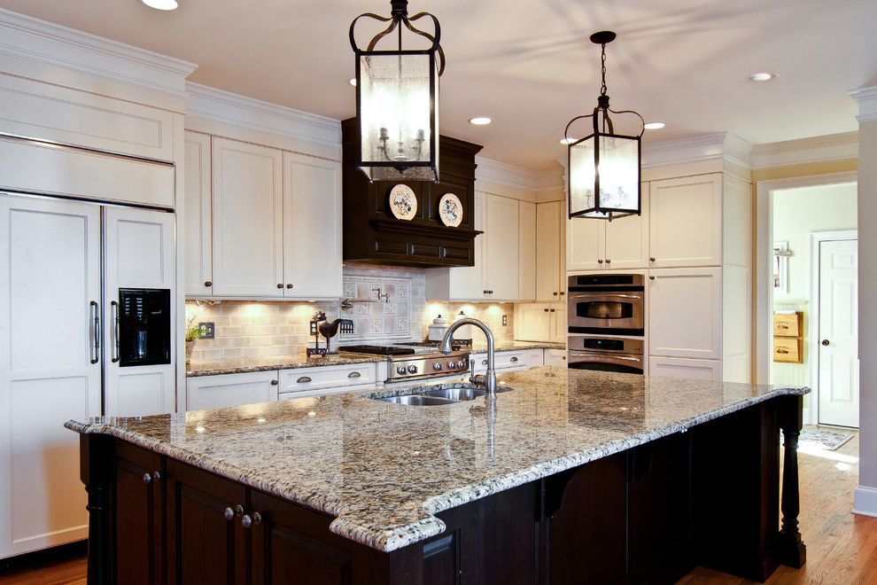 St Cecilia Granite Countertops   Traditional Kitchen  and Brown and Cream Kitchen Brown Wood Island Cream Cabinets New Venetian Gold Granite Oak Island Ogee Edge Granite Counter Tops Panel Front Refrigerator Pendant Lighting by Troy