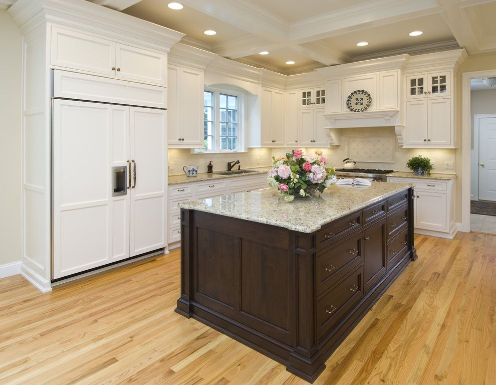 St Cecilia Granite Countertops with Traditional Kitchen Also Coffered Ceiling Dark Stained Wood Frame and Panel Granite Counters Hood Integrated Kitchen Natural Wood Recessed Lights Stainless Steel Tile Back Splash White Painted Cabinets Wood Floor