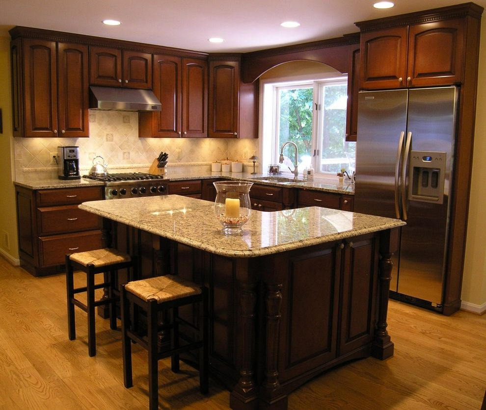 St Cecilia Granite Countertops with Traditional Kitchen  and Arched Doors Cherry Wood Custom Dark Cherry Dark Stain Eat in Kitchen Granite Countertops Island Island Seating Maple Wood Ogee Edge Santa Cecelia Turned Post Wood Cabinets