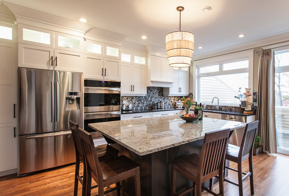 St Cecilia Granite Countertops with Traditional Kitchen  and Barstools Drum Pendant Glass Doors Granite Island Kitchen Appliances Modern Mosaic Tile Pendant Lighting Stainless Tile Backsplash Traditional Wood Wood Floors
