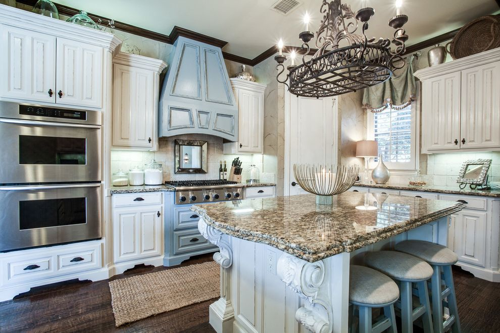 St Cecilia Granite Countertops with Traditional Kitchen  and Blue Hood Corbels Cream Cabinets Hand Painted Finish Jute Rug Kitchen Island Warm Wrought Iron Chandelier