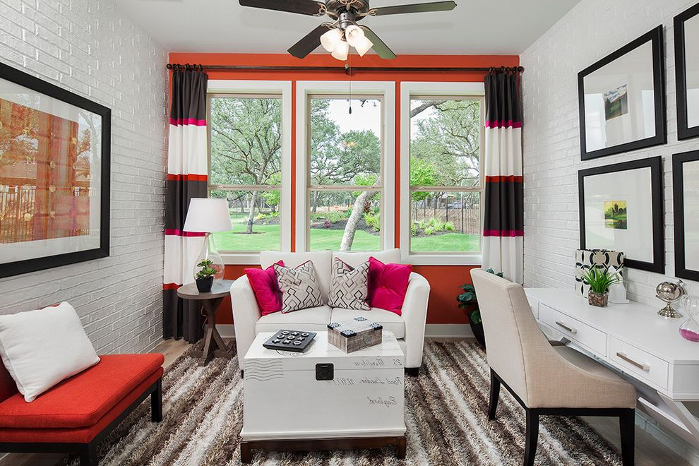 Standard Pacific Homes Austin   Contemporary Home Office  and Black Stripes Bright Pink Accent Pillows Orange Accent Wall Painted Brick Walls Striped Curtains Striped Rug Trunk Coffee Table Upholstered Chair White Desk White Window Trim