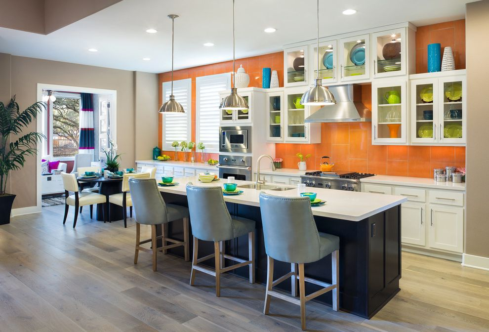 Standard Pacific Homes Austin with Contemporary Kitchen  and Gray Counter Stools Industrial Pendant Lights Kitchen Island Lighting Light Wood Floor Orange Accent Wall Pedestal Table Round Kitchen Table