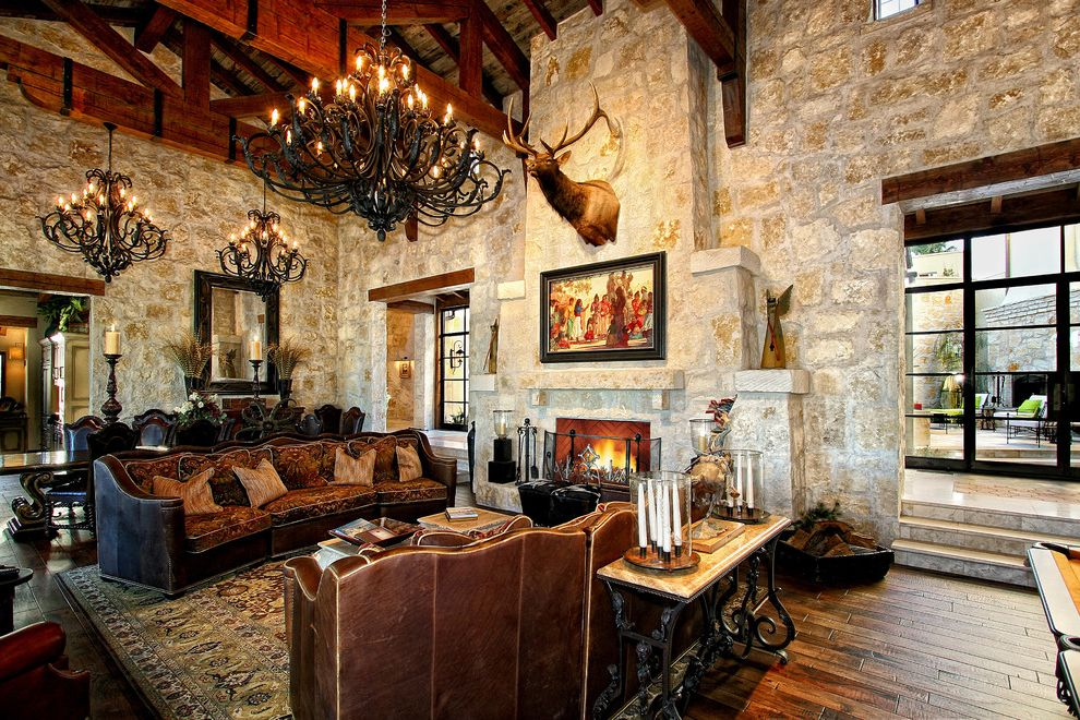 Standard Pacific Homes Austin with Mediterranean Family Room  and Chandelier Fireplace High Ceiling Italy Leather Sofa Rustic Stone Toscana Wood Beams Wood Trim