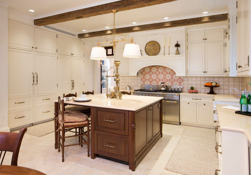 Subzero Refrigerators with Victorian Kitchen  and Beige Floor Tile Recessed Lighting Red and White Tile Backsplash White Cabinets Wood Beams Wood Island