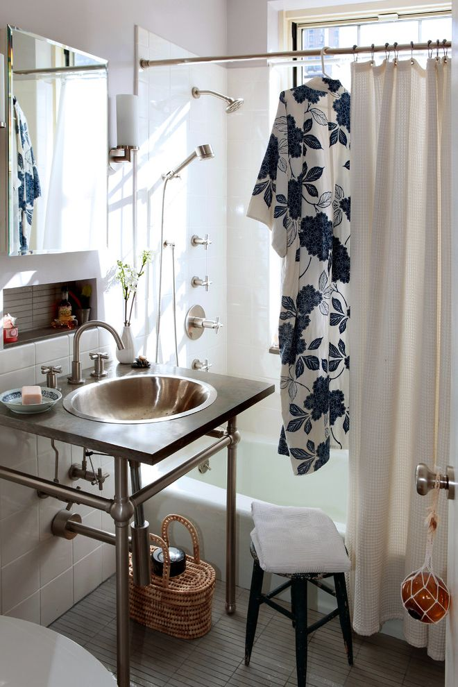 T&a Supply with Eclectic Bathroom  and Inset Shelves Limestone Countertop Mirror Shower Shower Curtains Sink Storage Basket Tile Floors Vanity